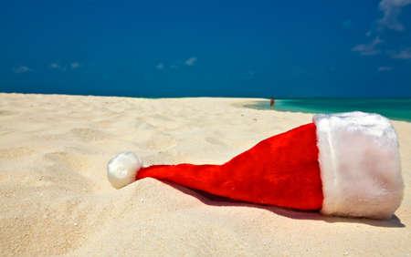 Santa hat is on infinity coral sandy beach Stock Photo