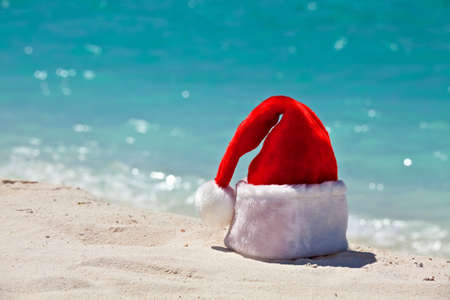 Santa hat is on a coral sandy beach Stock Photo - 13148129
