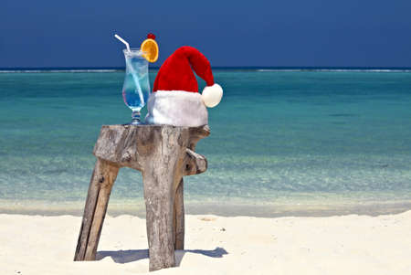 bocal: Bocal of tonic water is on original  beach table is made from trunk of tree with Santa hat
