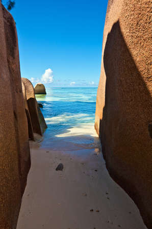 Nice beach path under a big stones, Seychelles, La Digue island photo