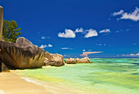 Dream seascape view with a big stones and palmtree, Seychelles, La Digue island Stock Photo - 13148510