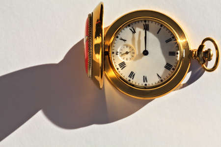 12 o'clock: Pocket watch is on white paper Stock Photo