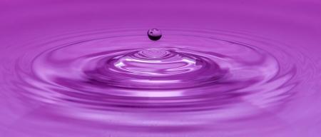 Drop water violet Reklamní fotografie