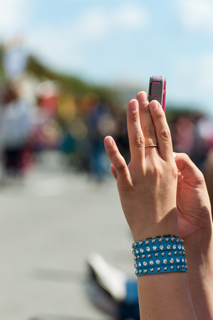 Hand of a girl to a mobile phone Stock Photo