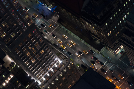 Street Manhattan New York City at night full of cars and taxis