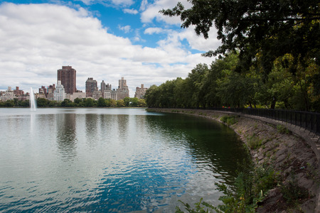 Panorama of manhattan new york city central park by the lake