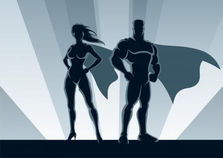 Männliche und weibliche Superhelden, posiert vor einem Licht.