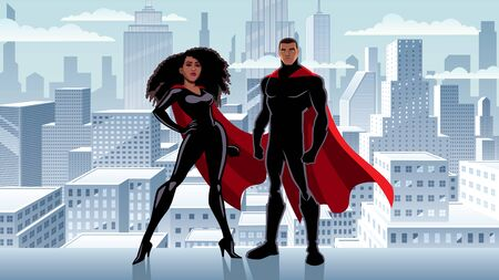 Male and female black superheroes posing in front of beautiful winter cityscape.
