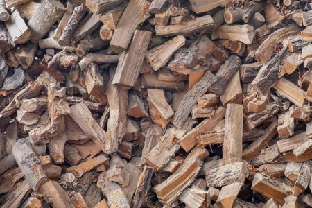 Chopped firewood on a stack. Background of dry chopped firewood logs in a pile. Texture, wallpaper. 写真素材