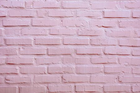 Painted brick wall in pink color. Texture.