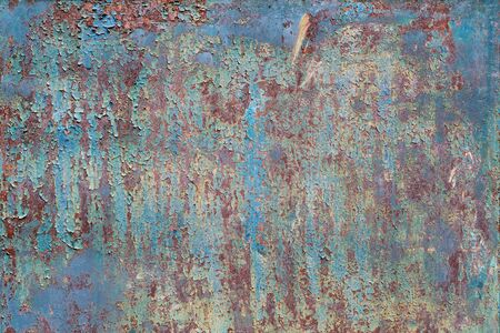 Painted metal with cracks in the paint, roughness, rust. Iron sheet covered with old paint, which has cracked from time and weather conditions. Rusty metal surface. Metal background, texture, backdrop