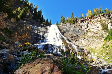 Spectacular mountain waterfalls and flowers. 写真素材