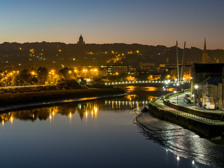 street lights: Lancaster City at dawn over River Lune with sunrise glow and street lights sparkling