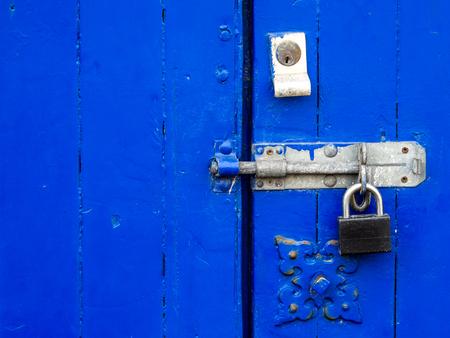 padlocked: Padlocked bright blue wooden doors with lock