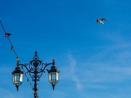 Vintage Lamps at Southsea, Portsmouth, clear blue sky, seagull and copyspace