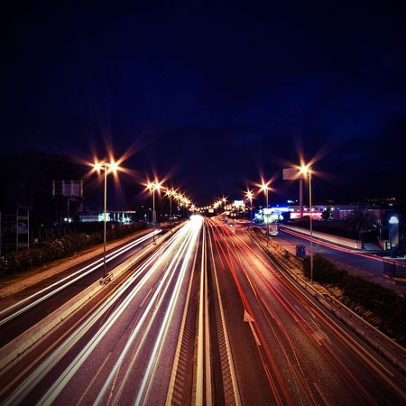 restlessness: The picture shows trails of light by cars.