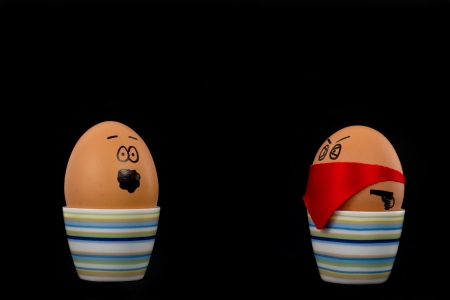 The picture shows an egg which is attacked by another one.