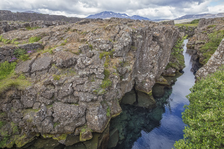 cloud drift: The picture shows the Silfra in Thingvellir National Park in Iceland. Stock Photo