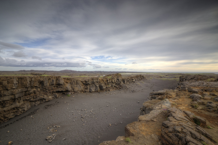 cloud drift: The picture shows a rift valley in Iceland, which is caused by continental drift.