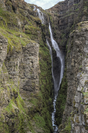 thundering: The picture shows Glymur one oft he highest waterfalls in Iceland. Stock Photo