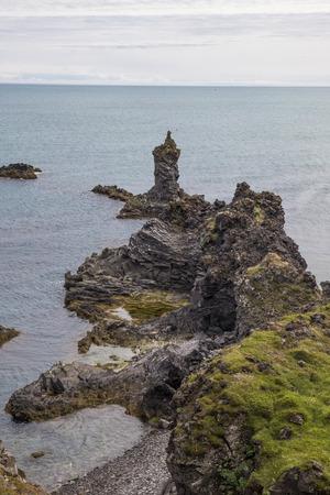 The picture shows the rocky coast near Arnarstapi, Iceland.