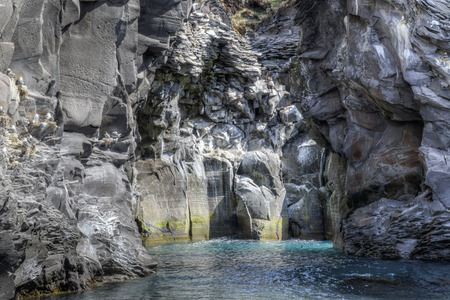 unaffected: The picture shows a rocky bay, near Hellnar in Iceland. Stock Photo
