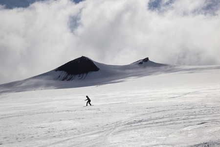 individualist: The picture shows a snowboarder who riding his snowboard at Snaefellsjokull.