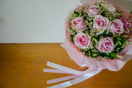 Pink rose bouquet and ribbon background