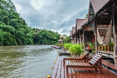 kanchanaburi: Beautiful wooden floating house resort by river Kwai among nature. Relaxing yourself with sound of nature.