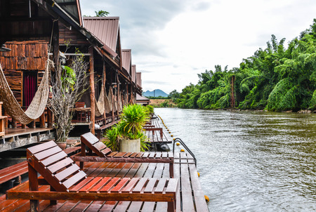 Beautiful wooden floating house resort by river Kwai among nature. Relaxing yourself with sound of nature.