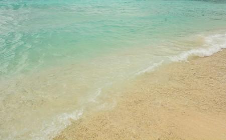 Clear blue sea on sand beach background
