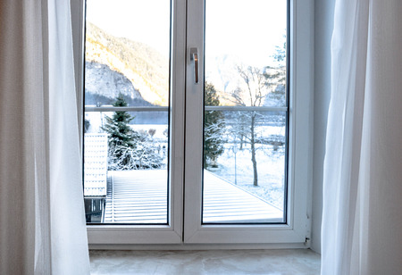 A view from window look out to see white snow covered landscape