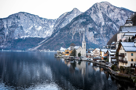 Beautiful landscape and water reflection of historical town by the Lake Hallstatt, Austria, Europe