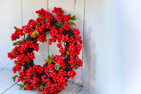 Christmas Red Holly Berry Wreath isolated on white wall background. Merry Christmas background.
