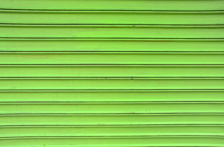 Green vintage rolling shutters background. Banque d'images - 102674031