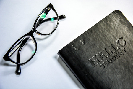 Studying and working icon, glasses and black cover notebook with Hello Student message Banque d'images - 102674028
