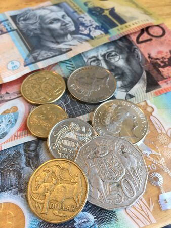 Australian Dollars (AUD) bank notes and coins background Banque d'images - 131633406