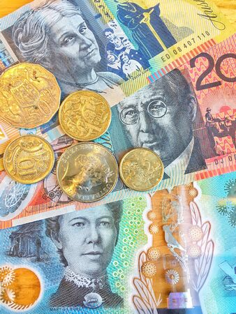 Australian Dollars (AUD) bank notes and coins background