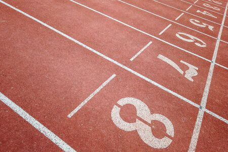 Background of running track surface with numbers with intersection lines