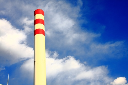 Chimney with red circle under blue sky photo