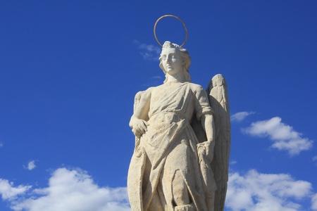 san rafael: statue of san rafael in cordoba Stock Photo