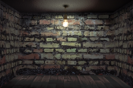 Dark room with brick walls photo