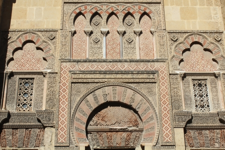 caliphate: Detail of the decoration of one of the many doors that can be found in the mosque of Cordoba - Spain Stock Photo