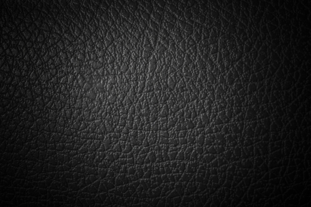 soft center: Black synthetic leather Stock Photo
