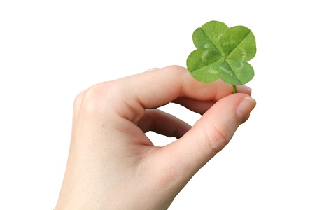 superstitions: Hand with a four-leaf clover isolated