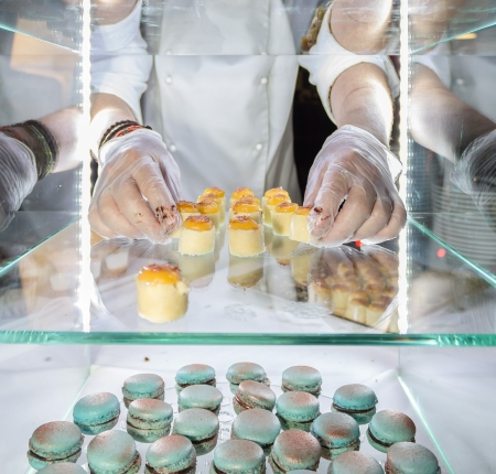 food hygiene: Hands of a pastry chef