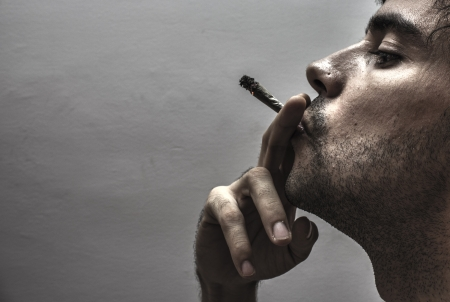Profile of a person smoking photo