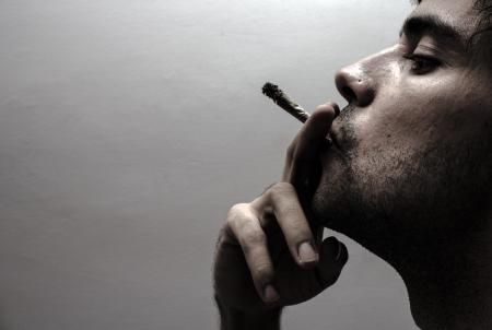 Profile of a person smoking