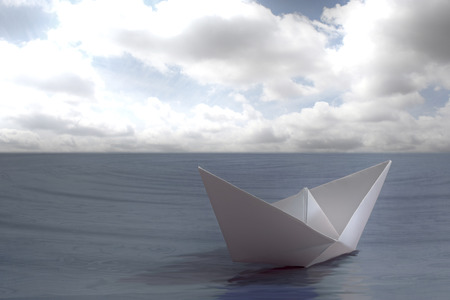 Paper boat floating in the sea