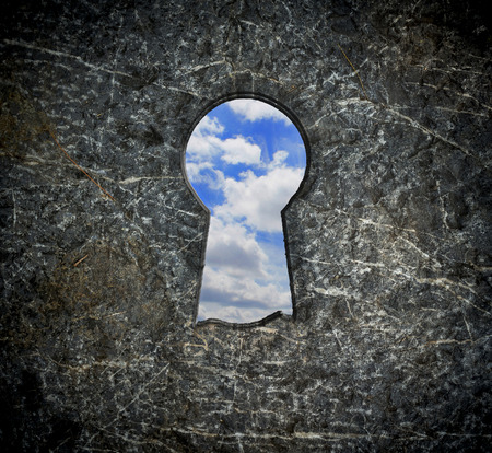 Locking stone over blue sky  Stock Photo
